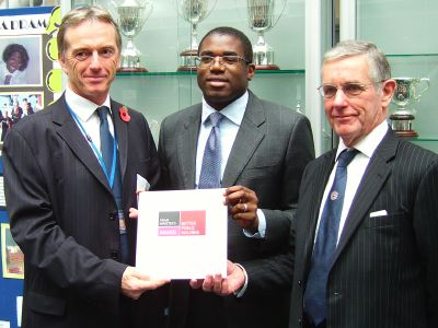 David Lammy (centre) presents the award to princip