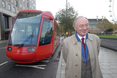 The Mayor of London poses with a mock-up tram in B