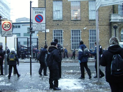 Snowball fight outside London Nautical School