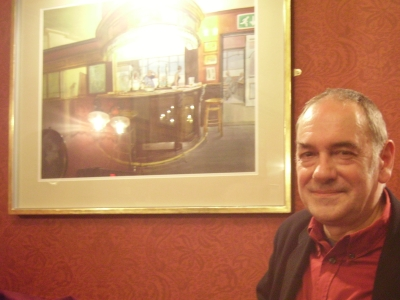 Mick Smee with his painting at the Royal Oak