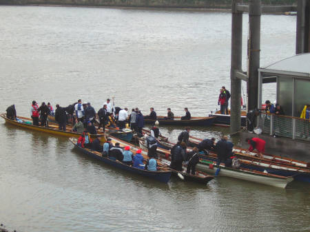 Participants in the Thames Cutters barge race dise