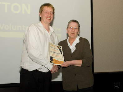 Pat Notton receives her award from Kevin Quinn of