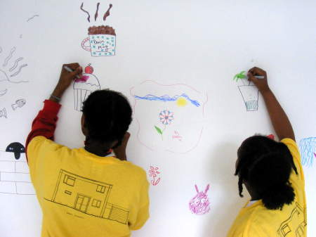 Cathedral School pupils decorate a wall in the Art
