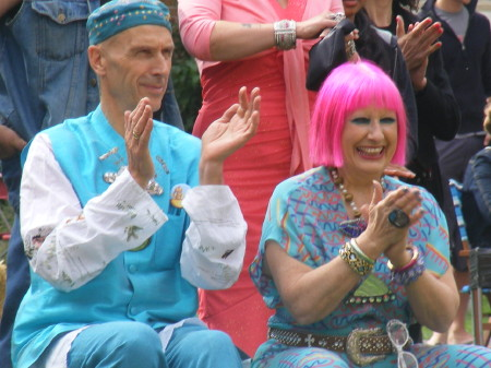 Andrew Logan and Zandra Rhodes perched on a hay ba