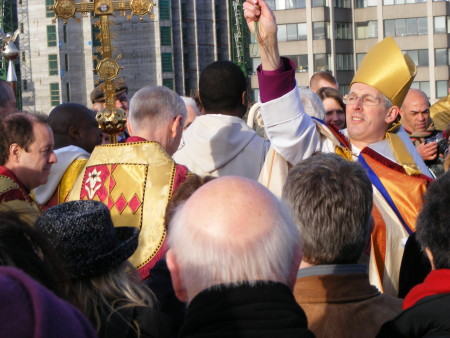 The Bishop of Woolwich sprinkled the crowd with ho