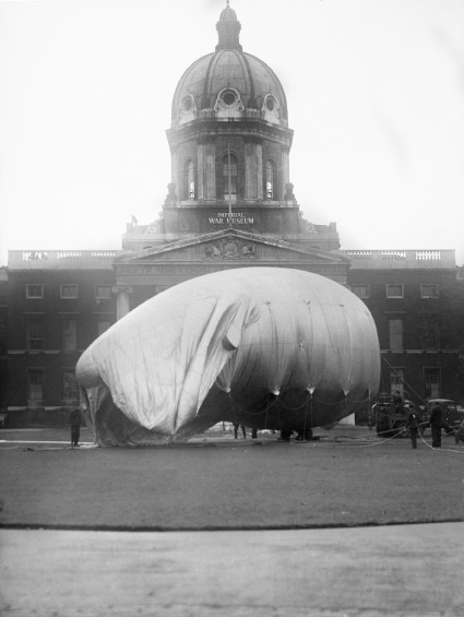 A barrage balloon is inflated outside the Imperial