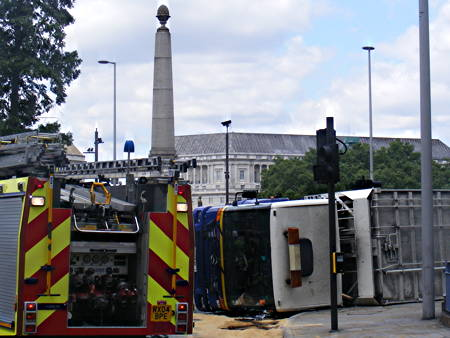 Dust cart overturns at Lambeth Bridge roundabout