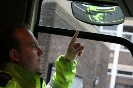 Cyclists get in the cab of a lorry at Southwark road safety event