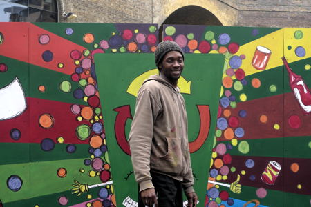 Street artist Nathan Bowen creates recycling mural in Borough Market