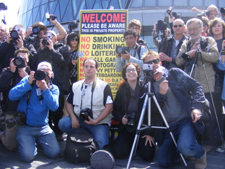 Snappers hold City Hall flashmob in protest at photography restrictions