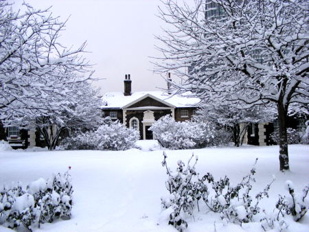 Hopton's Almshouses and gardens covered in snow in