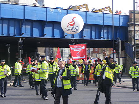 Construction workers march from the Shard to Blackfriars Station