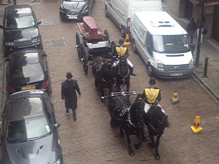 Funeral for unknown man as bodies dug up for rail viaduct are reburied