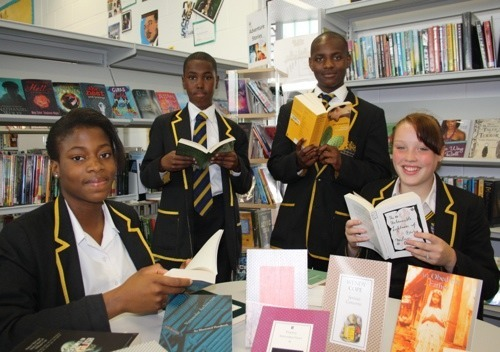 Lord Cholmondeley donates hundreds of books to Globe Academy