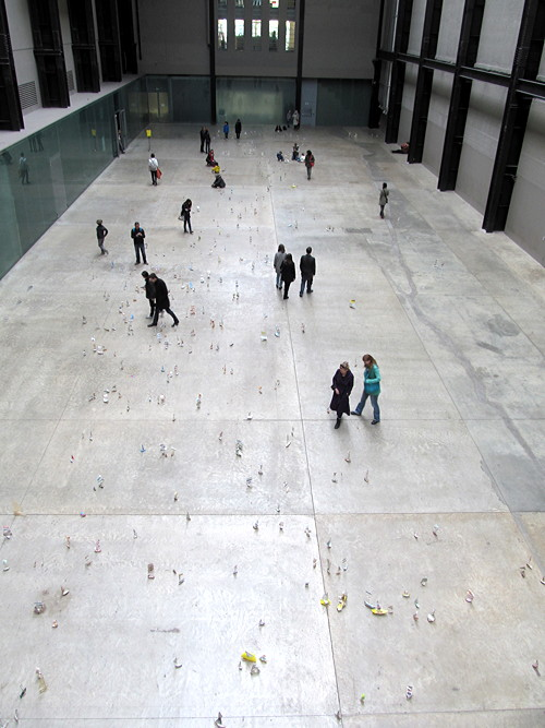 Tate Modern turbine hall filled with flotilla of paper boats