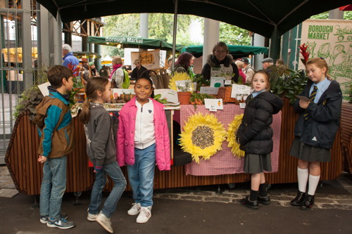 Young traders sell their harvest produce at Borough Market