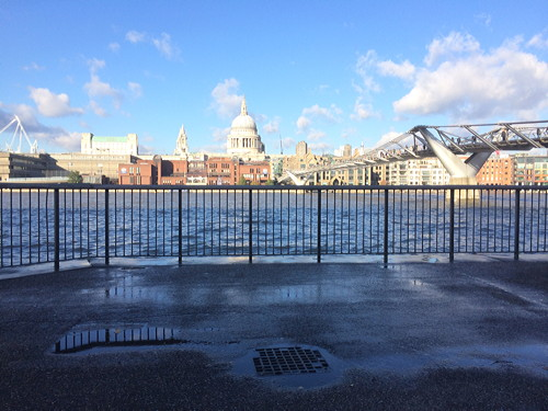 Waves break over Thames Path at Bankside after flood alert issued