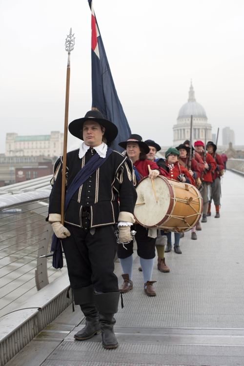 Roundheads march across Millennium Bridge
