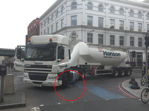 Cyclist escapes with minor injuries as bike is crushed by lorry