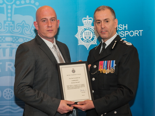 Commendation for ticket inspector who disarmed knife-wielding man