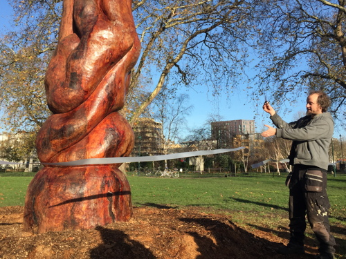Peace sculpture created from trunk of diseased plane tree