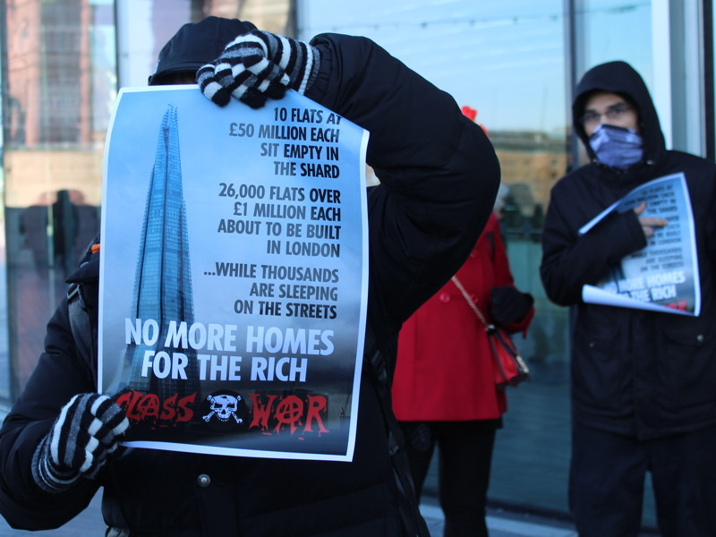 Class War anarchists march on the Shard in protest at empty flats