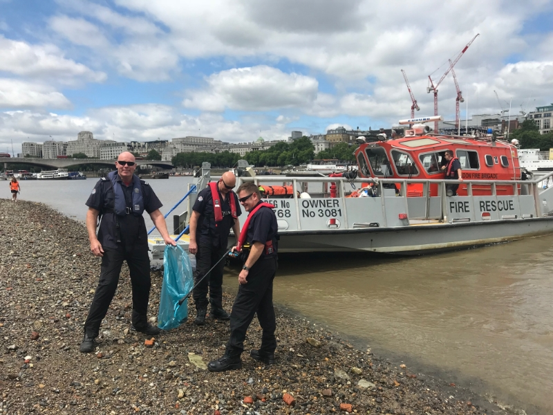 Firefighters join South Bank beach clean-up