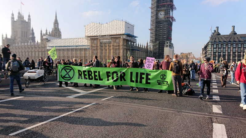Environmental protesters block five Thames bridges
